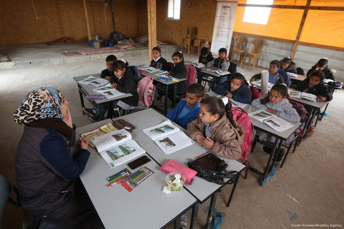 Palestinian children attend class in a school in Jerusalem on 3 January 2018 [Issam Rimawi/Anadolu Agency]