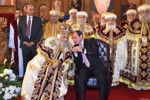 Egyptian Coptic Pope Tawadros II (L), Pope of Alexandria and Patriarch of Saint Marc Episcopate, receives Egyptian President Abdel Fattah al-Sisi (R), during the opening ceremony of the new Coptic Cathedral in Cairo, Egypt on January 6, 2018 [Egyptian Presidency / Handout - Anadolu Agency]