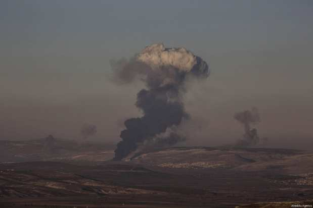 Smoke rises after Turkish jets destroyed observation posts and many other targets of PYD/PKK as part of the 'Operation Olive Branch' in Afrin, Syria on January 20, 2018 [Onur Çoban / Anadolu Agency]