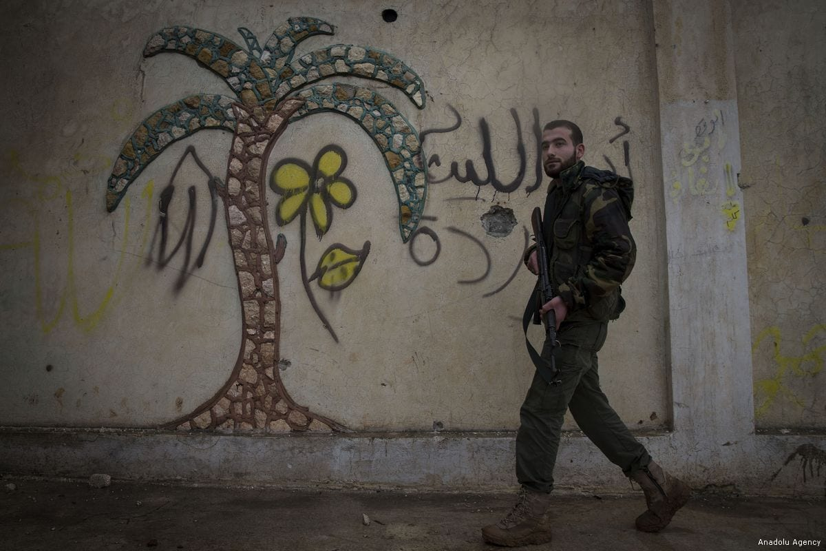 """A member of Free Syrian Army (FSA), backed by Turkish Army, patrols in Azez region of Aleppo, Syria within the """"Operation Olive Branch"""" against PYD/PKK in Afrin, on 26 January, 2018 [Emin Sansar/Anadolu Agency]"""