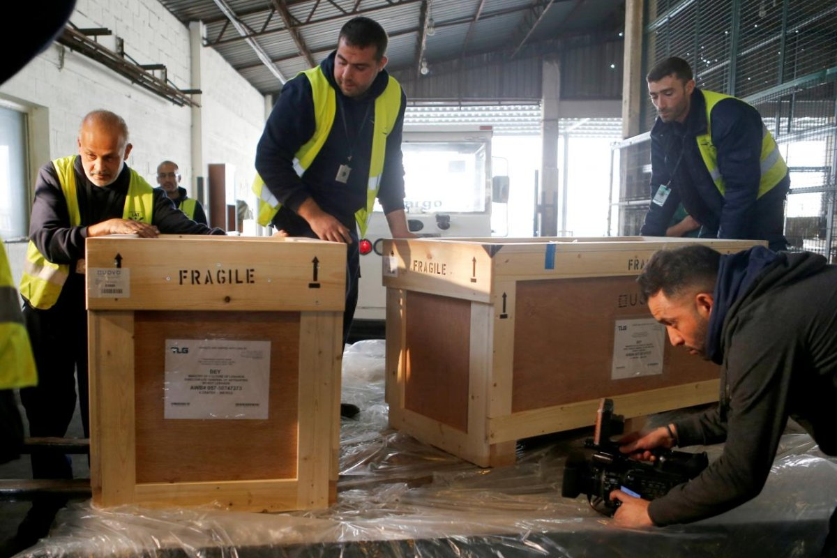 Workers unload boxes of artefacts at Beirut's International Airport, in Beirut, Lebanon 12 January 2018 [REUTERS/Mohamed Azakir]