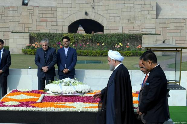 Iranian President Hassan Rouhani (2nd R) places a wreath at the Mausoleum of Mahatma Gandhi, who was the leader of the Indian independence movement, in New Delhi, India on February 17, 2018 [Iranian Presidency / Handout / Anadolu Agency]