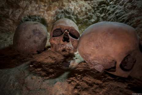 Skulls are seen one of the 3,000-Year-Old 8 pharaohs' tomb, which were dug out during archaeological excavations, is seen in Minya, Egypt on February 24, 2018 [İbrahim Ramadan / Anadolu Agency]