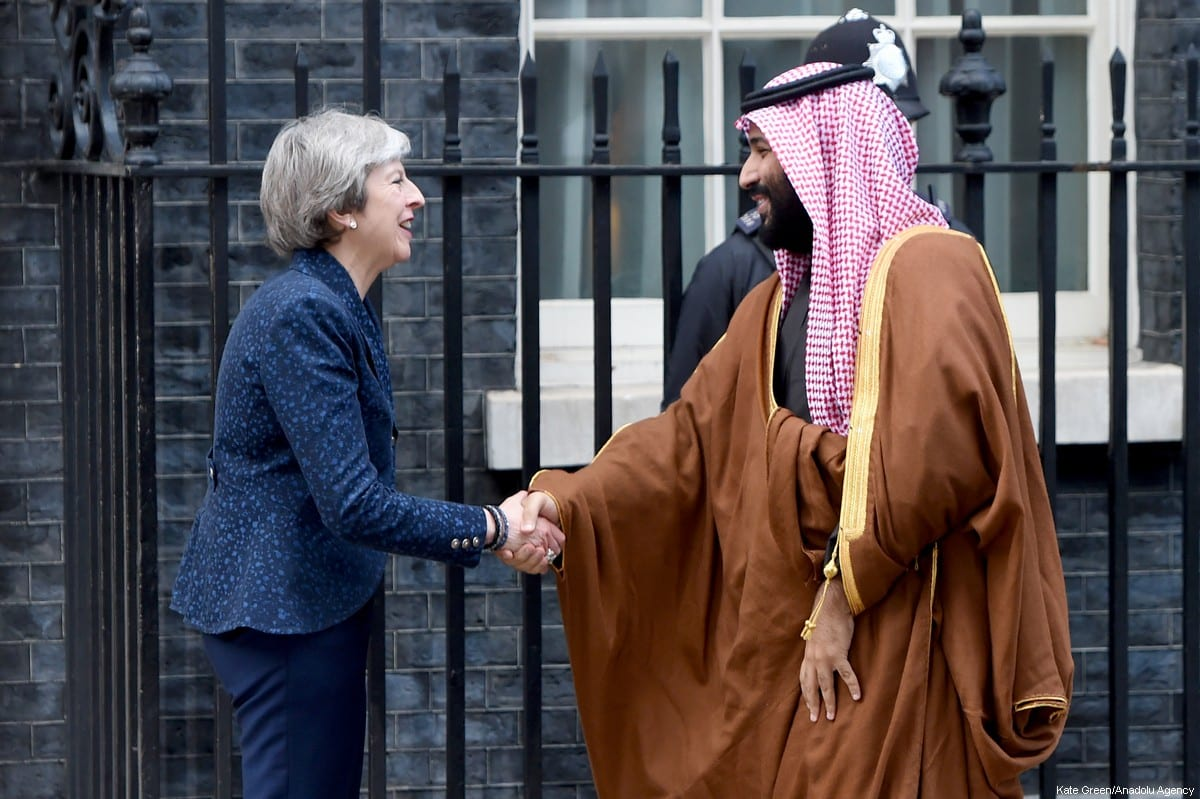 British Prime Minister Theresa May (L) greets The Crown Prince of Saudi Arabia Mohammad bin Salman al-Saud (R) on the steps of No.10 Downing Street, as he arrives for a meeting in London, United Kingdom on 7 March, 2018 [Kate Green/Anadolu Agency]