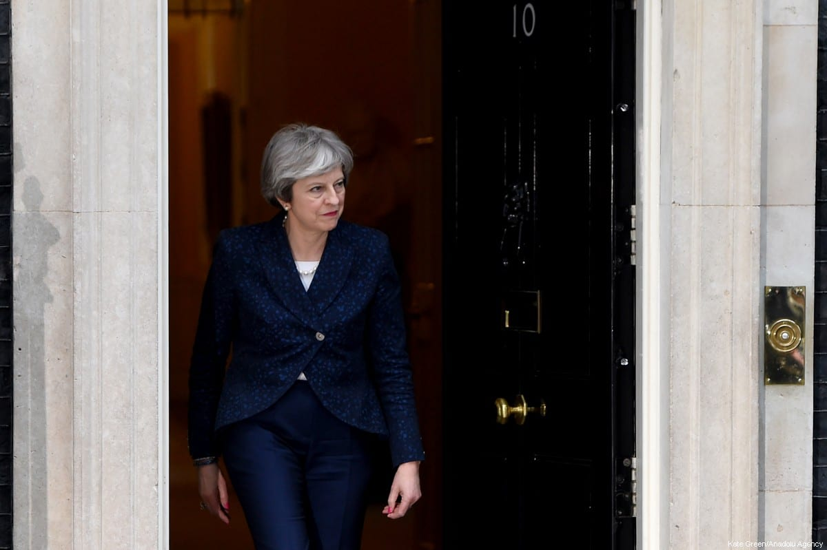 May mulls Syria action despite cautious mood in United Kingdom