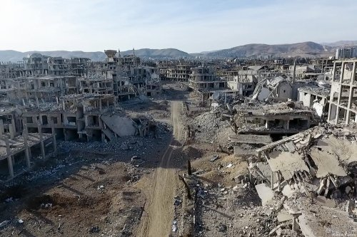 Screengrab from footage captured by a drone shows wreckages of structures of Arbin town, which has been under siege of Assad Regime, in Eastern Ghouta region, Damascus, Syria on March 09, 2018 [Ammar Al Bushy / Anadolu Agency]