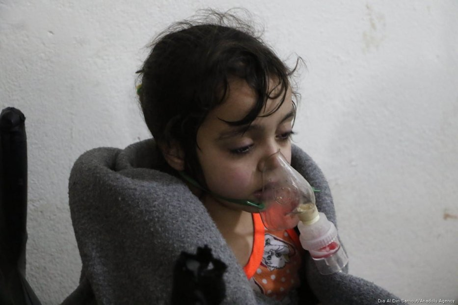 An affected child and a man receive a medical treatment after Assad regime forces conduct allegedly poisonous gas attack on Sakba and Hammuriye districts of Eastern Ghouta, in Damascus, Syria on 7 March, 2018 [Dia Al Din Samout/Anadolu Agency]