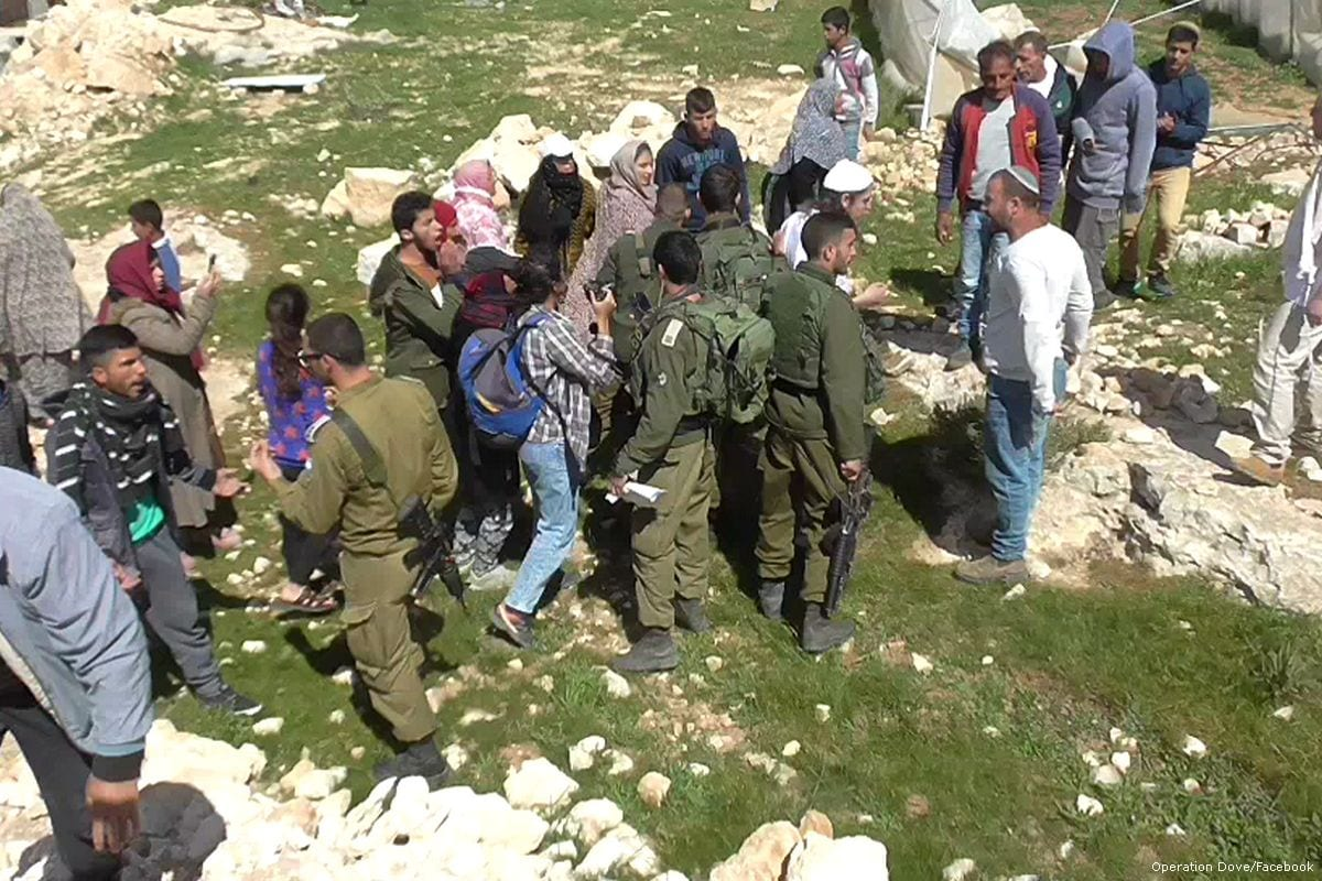 Israeli forces stand between Israeli settlers and Palestinians [Operation Dove/Facebook]
