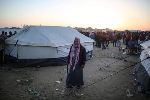 Palestinians stage a demonstration demanding the right of return in Khan Yunis, Gaza on 1 April 2018 [Mustafa Hassona/Anadolu Agency]
