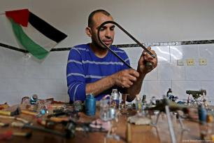 38-year-old Palestinian, Majdi Abu Taqiyya, is seen turning bullet cases and gas canisters, that had been shot by Israeli forces towards Palestinians, into works of art in Gaza City, Gaza [Ashraf Amra/Anadolu Agency]