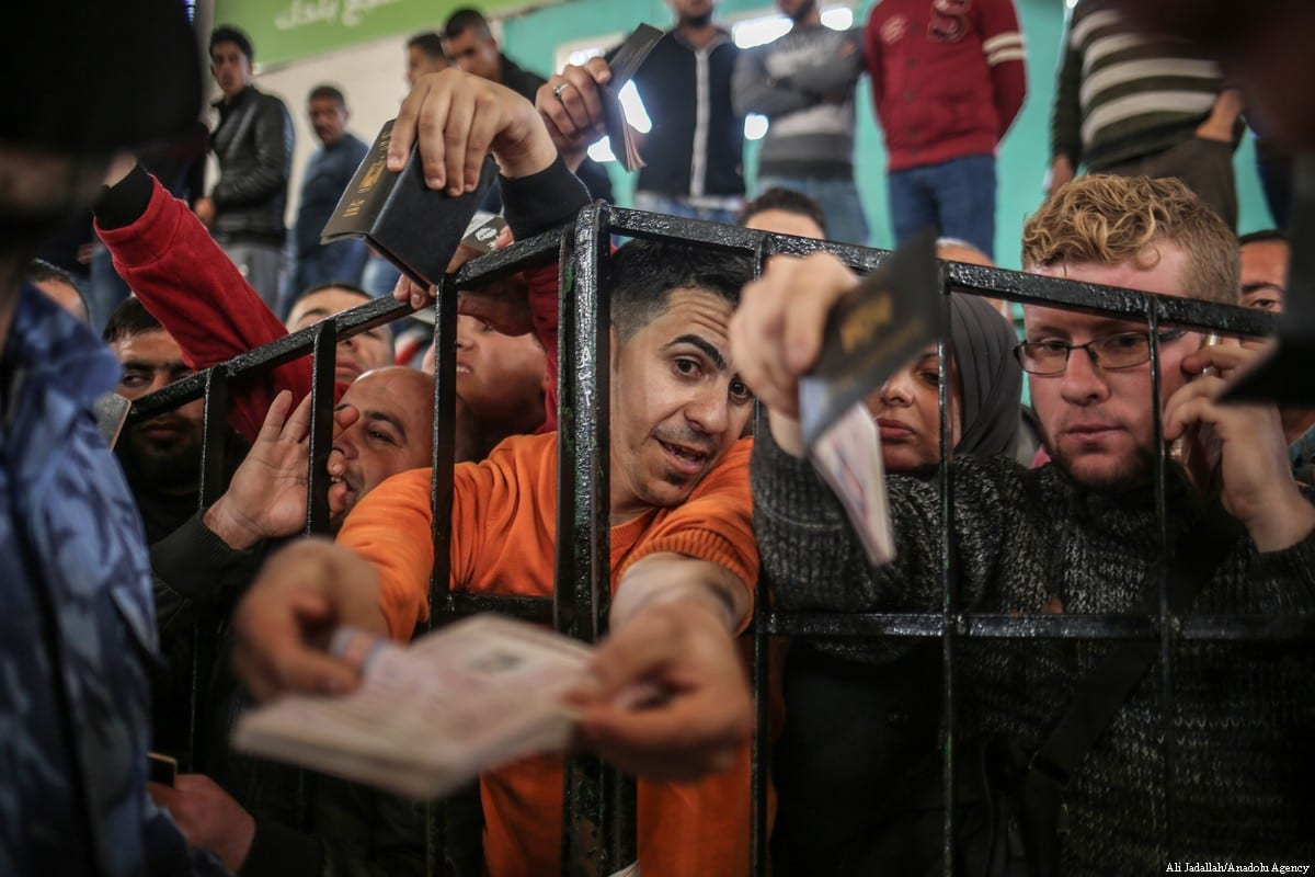 Palestinians wait in line for passport transactions to cross to Egypt following the opening of Rafah border gate in Khan Yunis [Ali Jadallah/Anadolu Agency]