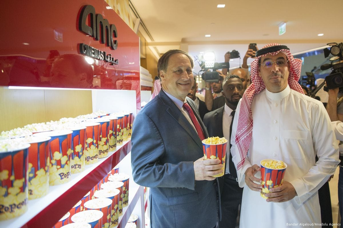 Saudi ministers can be seen eating popcorn during the opening ceremony of the AMC Entertainment Cinema in Riyadh, Saudi Arabia on 18 April 2018 [Bandar Algaloud/Saudi Kingdom Council/Anadolu Agency]