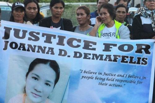 Protest in the Philipines seeking justice for the murder of Joanna Demafelis. Filipino maid Joanna Demafelis, was killed by her Kuwaiti employers, who then hid her body in a freezer.