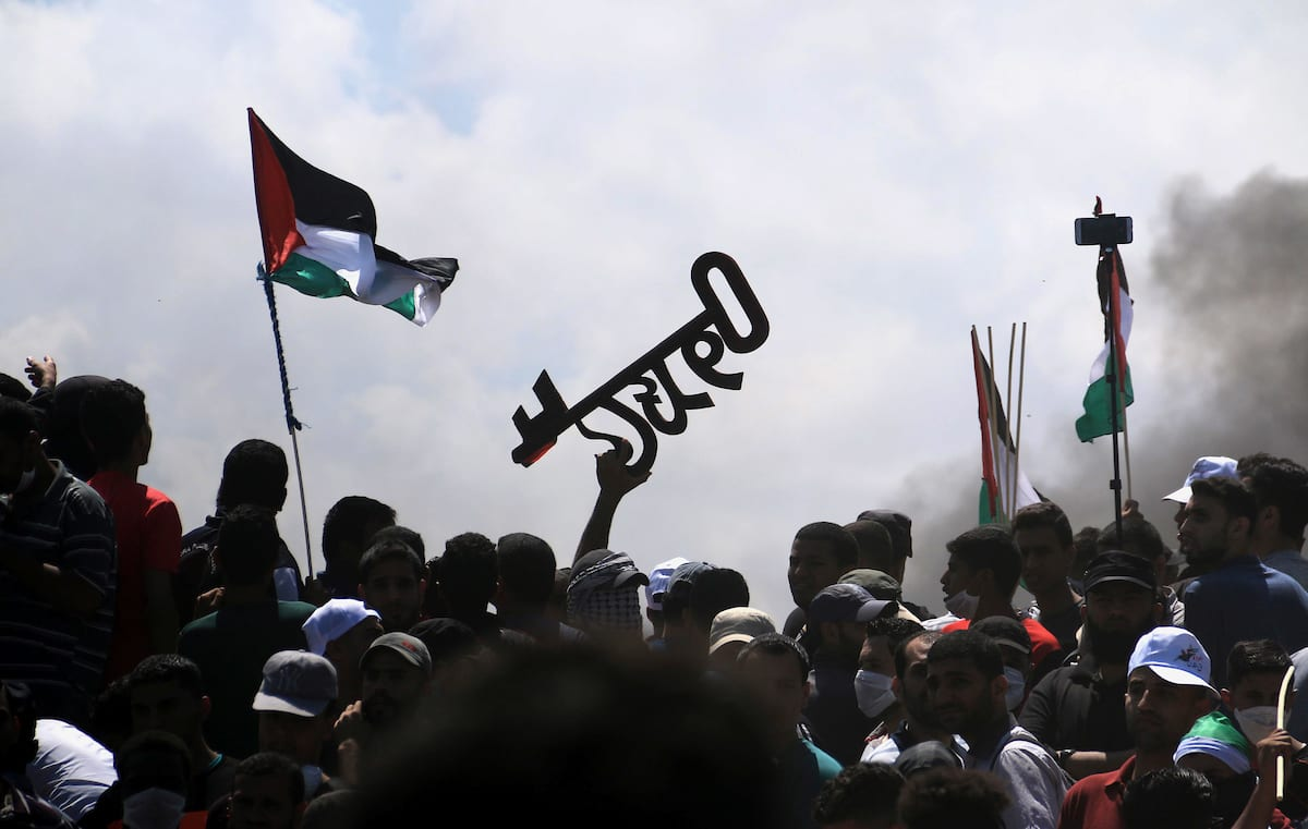 "Palestinian protesters gather during clashes with Israeli security froces in a tent city protest where Palestinians demand the right to return to their homeland, on the occasion of the 70th anniversary of the ""Nakba"", and against U.S. embassy move to Jerusalem at Israel-Gaza border at the Israel-Gaza border, in al-Bureij in the center of Gaza Strip on 14 May, 2018 [Mahmoud Khattab/Apaimages]"