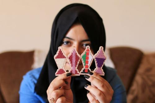 """A Palestinian girl Nariman Abu Obaid, 21, uses strings to embroidery on wood as she manufactures traditional lanterns known in Arabic as """"Fanous"""" on the holy month of Ramadan in Deir Al Balah in the center of Gaza Strip, on 17 May, 2018 [Mahmoud Khattab/A[aimages]"""