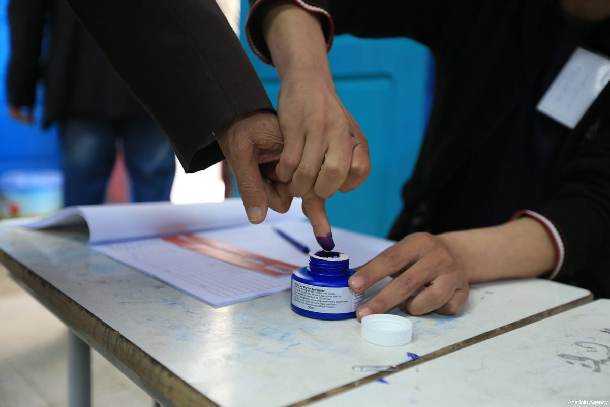 A man inks his finger after casting his vote at a polling station during Tunisian local elections, which was held first time after 2011 Arab Spring revolution, in Ben Arous, Tunisia on May 06, 2018. ( Yassine Gaidi - Anadolu Agency )