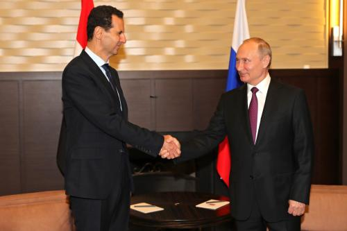 Russian President Vladimir Putin (R) meets President of Syria Bashar Al-Assad (L) in Sochi, Russia on 17 May, 2018 [Kremlin Press Office/Anadolu Agency]