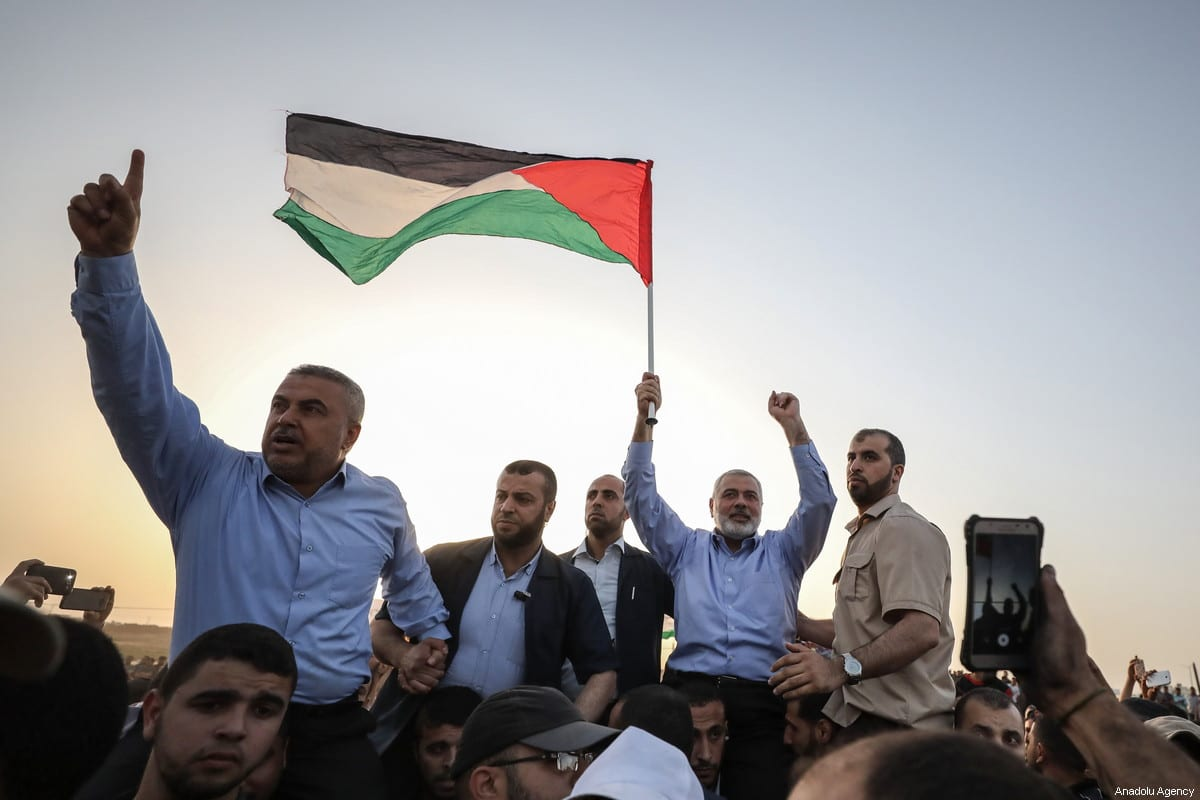 Head of the Political Bureau of Hamas, Ismail Haniyeh (2nd R) attends a demonstration, organized to mark 70th anniversary of Nakba, also known as Day of the Catastrophe in 1948, and against US decision to relocate the U.S. Embassy from Tel Aviv to Jerusalem, near Gaza-Israel border on 18 May, 2018 in Gaza City, Gaza [Ali Jadallah/Anadolu Agency]
