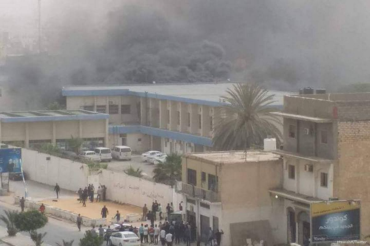 Smoke rises after a suicide attack took place in Libya's High National Elections Commission headquarters on 2 May 2018 [HtewishM/Twitter ]