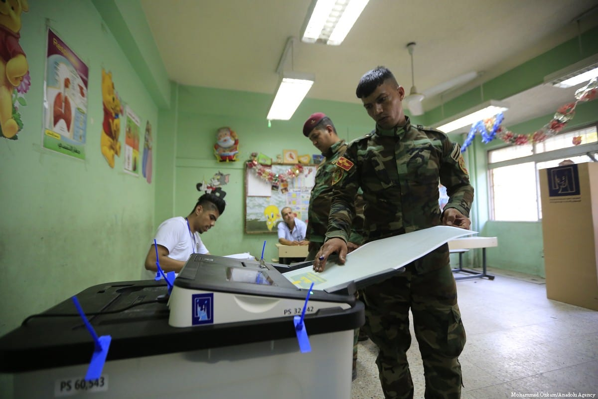 Iraqi security forces cast their vote during the Iraqi parliamentary election in Baghdad, Iraq on 10 May 2018 [Murtadha Sudani/Anadolu Agency]