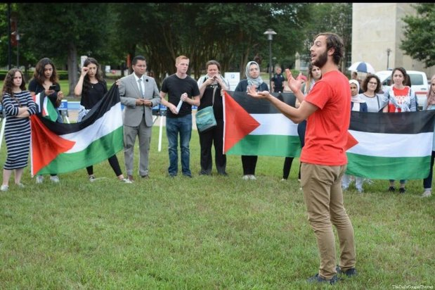 Pro-Palestinian activists walk out of a talk by UN envoy to the UN, Nikki Haley, at the University of Houston on 22 May 2018. The students disrupted her speech saying she 'signed off on genocide'