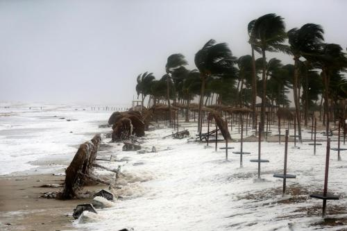 Debris and sea foam litters a beach during Cyclone Mekunu in Salalah, Oman, May 26, 2018 [Kamran Jebreili / AP Photo]