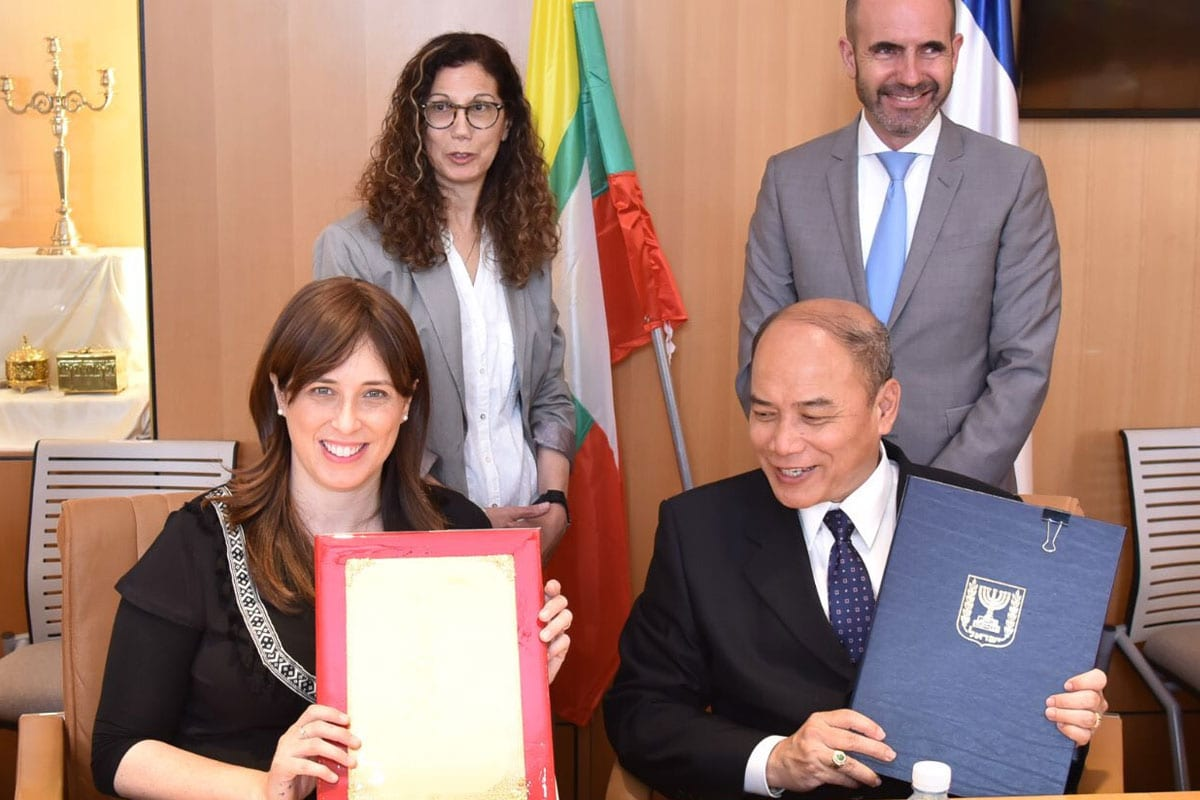 Tzipi Hotovely, Israel's Deputy Minister of Foreign Affairs [left] signs an 'Education Agreement' with U Maung Maung Lynn, Myanmar's ambassador to Israel, on May 28, 2018 in Myanmar [Twitter / TzipiHotovely]