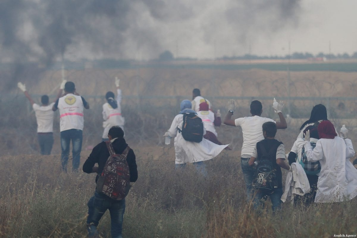 "21 year old Palestinian volunteer paramedic Rezzan en-Neccar (Rear 3rd L) is seen during ""From Gaza to Haifa: Unity of Blood and Shared Destiny"" protest at the Gaza-Israel border in eastern Khan Yunis, Gaza before she was killed by Israeli forces on June 1, 2018 [Ashraf Amra / Anadolu Agency]"