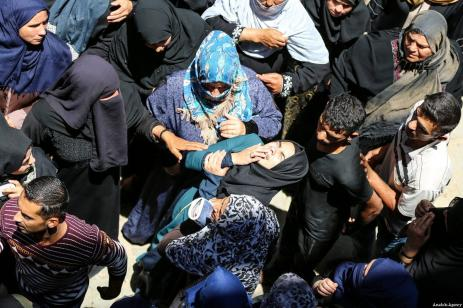 Palestinians mourn during the funeral ceremony of Razan Ashraf Najjar, 21, a female paramedic who was shot dead by Israeli forces while healing wounded demonstrators during 'Great March of Return' protests in Khan Yunis on Friday, in Huzaa neighbourhood of Khan Yunis, Gaza on June 02, 2018 [Mustafa Hassona / Anadolu Agency]
