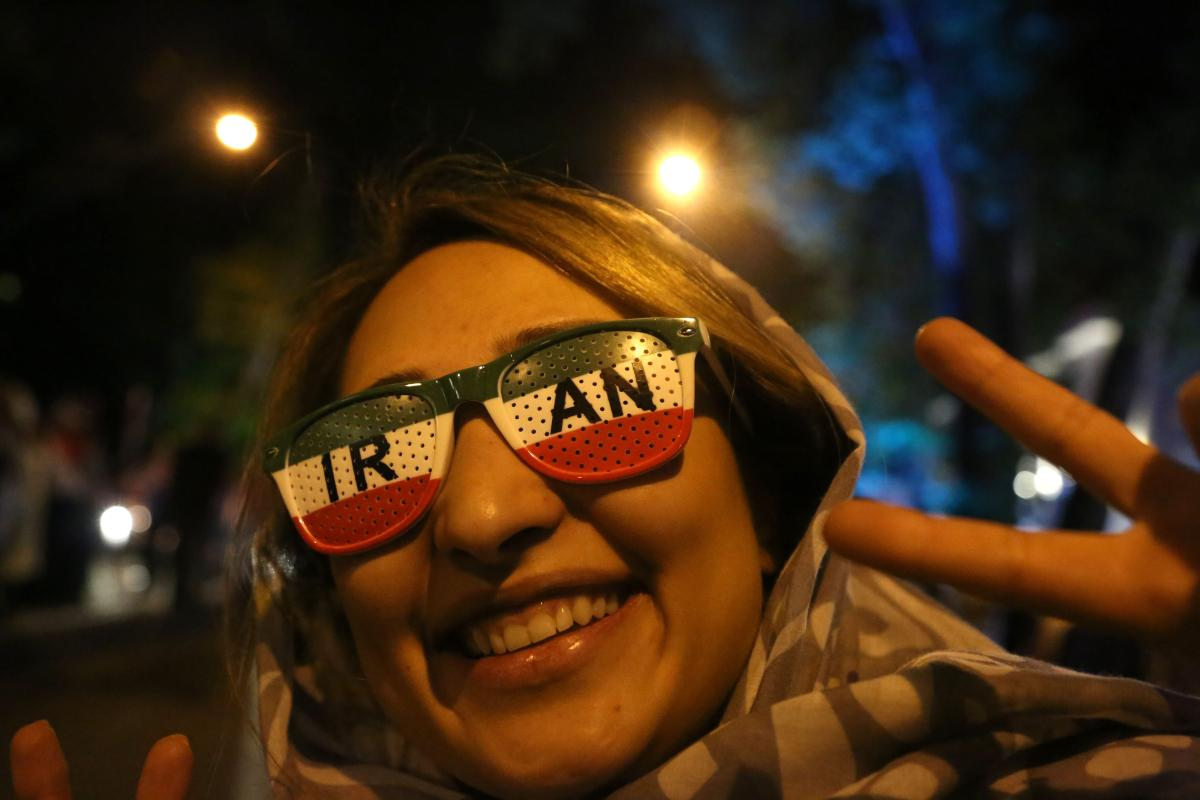 Iranians celebrate their victory after they won 2018 FIFA World Cup Russia Group B match against Morocco on 15 June, 2018 in Tehran, Iran [Fatemeh Bahrami/Anadolu Agency]