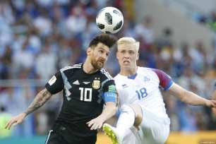 Lionel Messi (10) of Argentina in action against Hordur Magnusson (18) of Iceland during the 2018 FIFA World Cup Russia Group D match between Argentina and Iceland at Spartak Stadium on June 16, 2018 in Moscow, Russia. ( Sefa Karacan - Anadolu Agency )