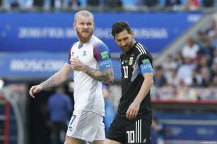 Aron Gunnarsson (L) of Iceland and Lionel Messi (R) of Argentina are seen during the 2018 FIFA World Cup Russia Group D match between Argentina and Iceland at Spartak Stadium on June 16, 2018 in Moscow, Russia. ( Sefa Karacan - Anadolu Agency )