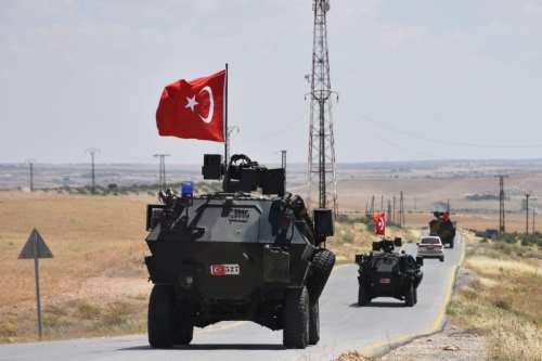 Armoured vehicles of Turkish Armed Forces are seen as they begin a second round of patrolling in the northern Syrian city of Manbij as part of the objective to clear the area of the YPG/PKK fighters on June 20, 2018 [Saher el Hacci / Anadolu Agency]