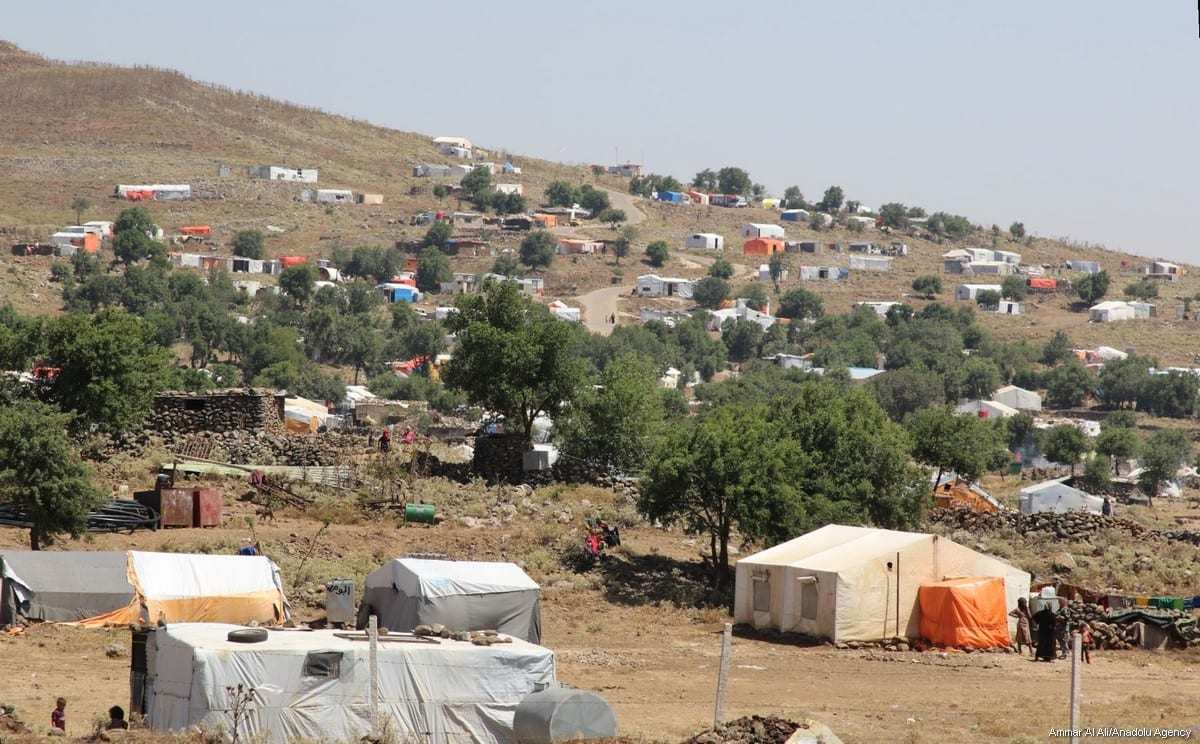 Syrian families are seen near the Golan Heights and the Israel-Jordan border after they fled from the ongoing military operations by Bashar al-Assad regime and its supporters in Syria's Daraa, on 27 June, 2018 [Ammar Al Ali/Anadolu Agency]