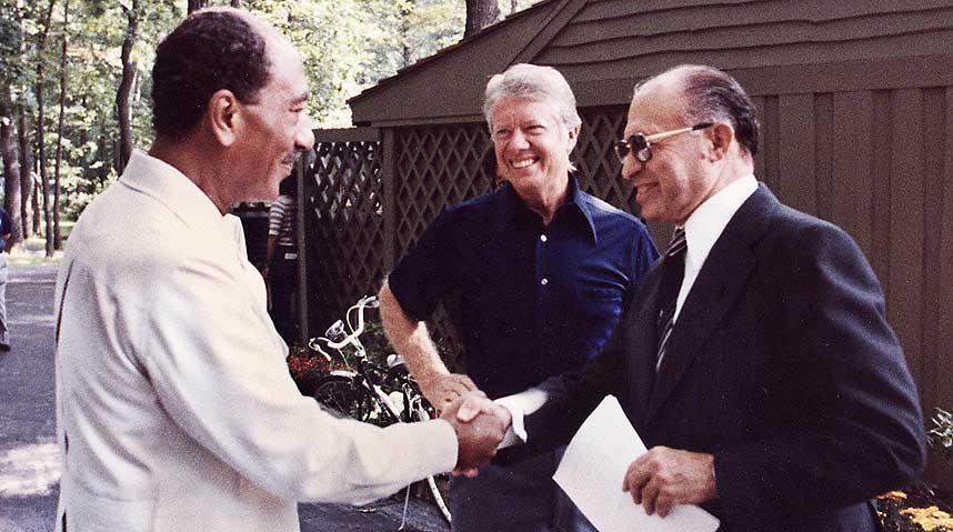 Israeli prime minister Menachem Begin and Egyptian president Anwar Sadat with US president Jimmy Carter at Camp David in September 1978 [US Gov]
