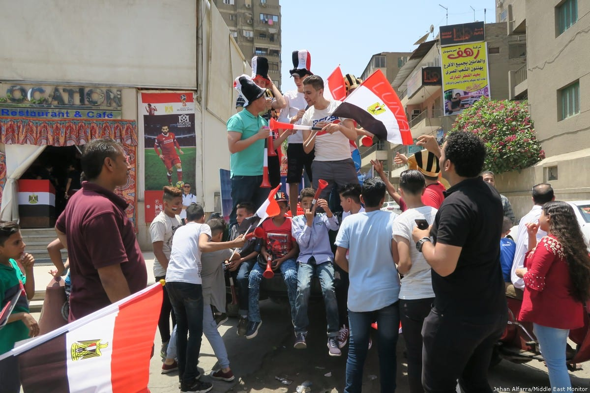 People celebrate the Football World Cup match between Russia and Egypt in Cairo, Egypt [Jehan Alfarra/Middle East Monitor]