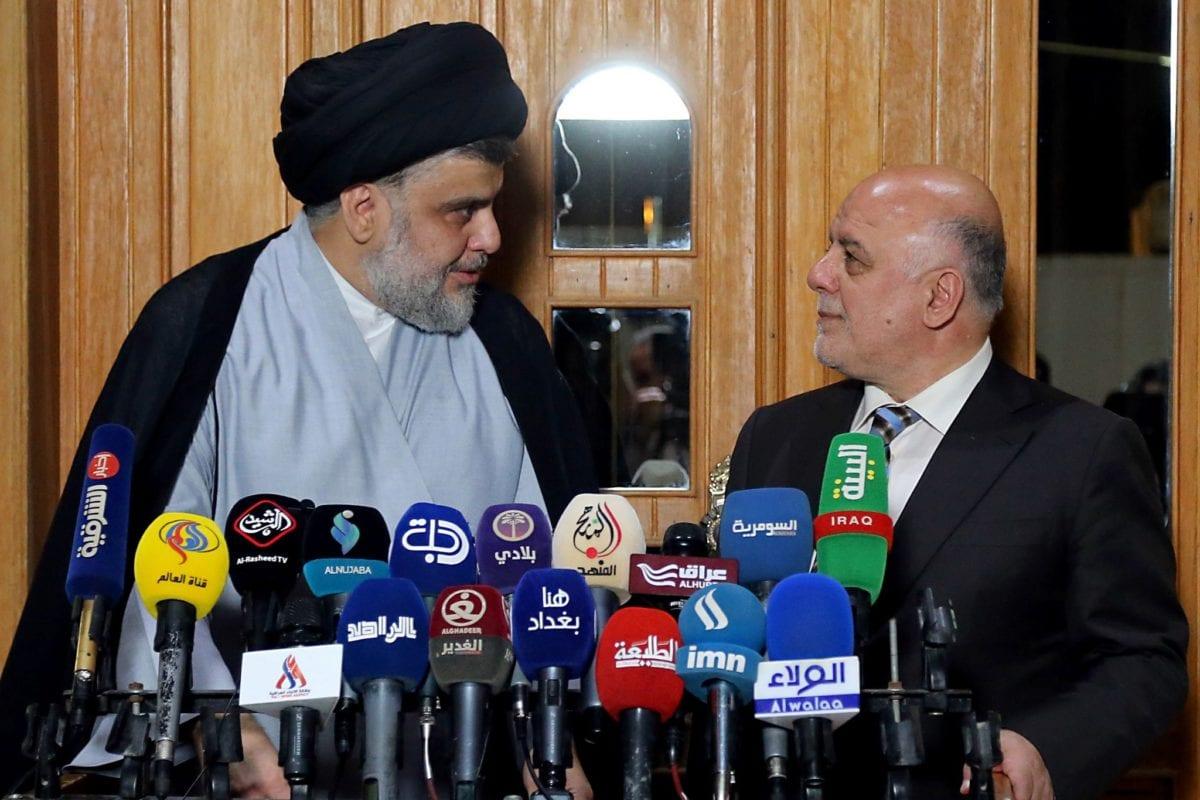 The leader of Iraq's Sadrist Movement,Muqtada Al-Sadr (L) and Iraqi Prime Minister Haider al-Abadi