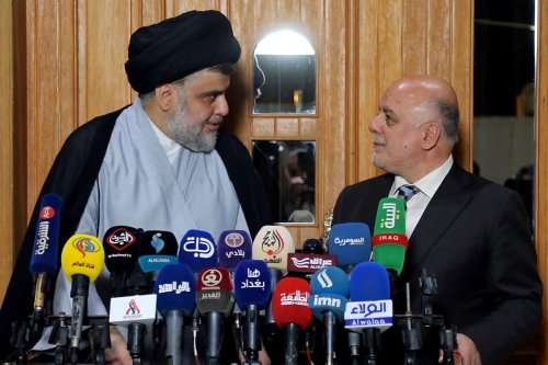 The leader of Iraq's Sadrist Movement, Muqtada Al-Sadr (L) and Iraqi Prime Minister Haider al-Abadi