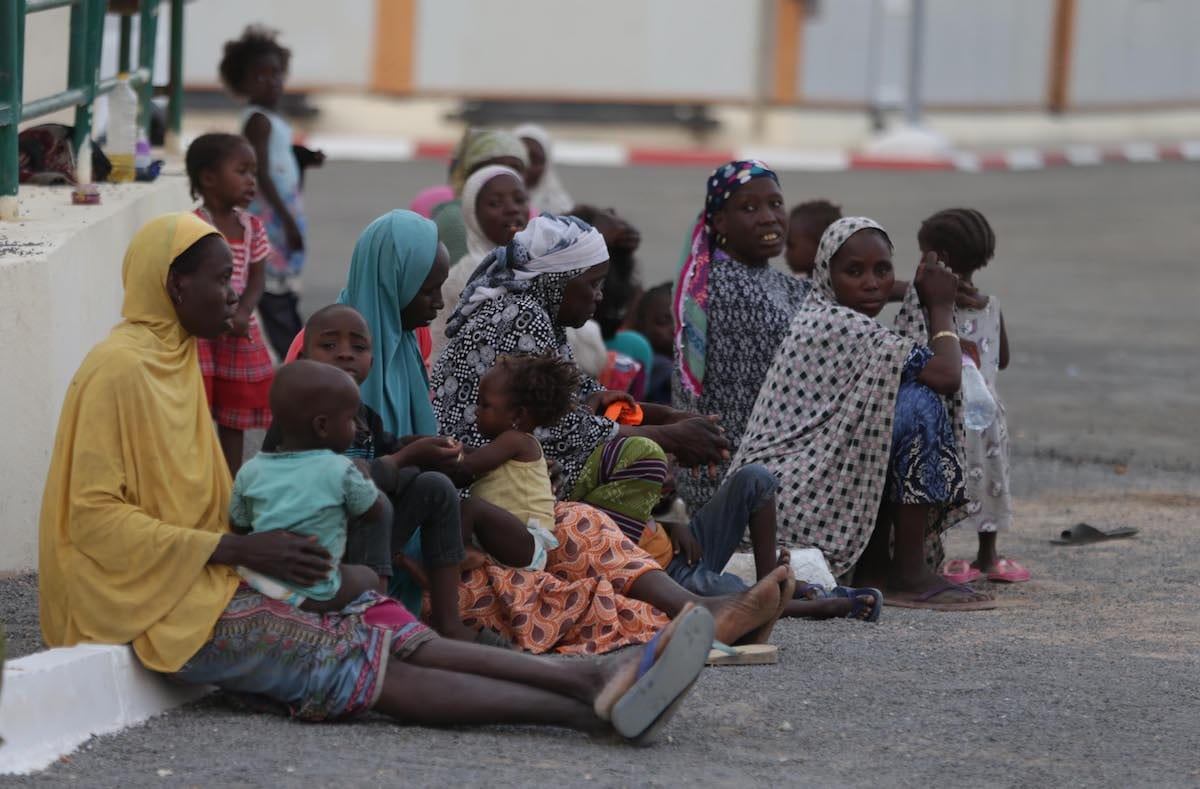 Migrants who will be repatriated to their countries by Algeria are seen at a temporary refuge centre [Farouk Batiche/Anadolu Agency]
