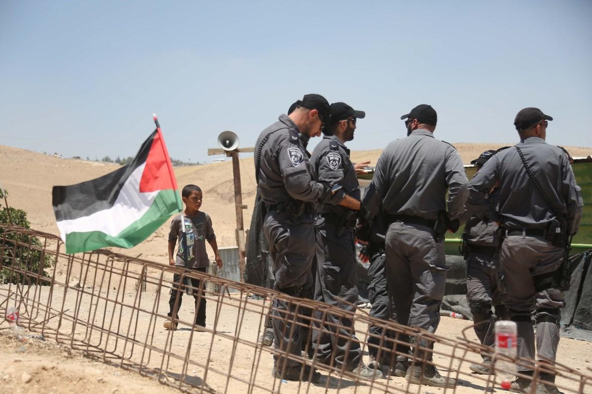 Israeli forces raise security as Palestinians keep watch in Khan al-Ahmar village following Israel's residential unit plans in eastern Jerusalem on 5 July, 2018 [Issam Rimawi/Anadolu Agency]