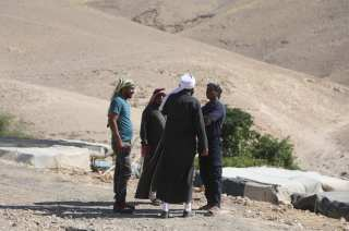 Palestinians continue to wait in Khan al-Ahmar village after Israeli High Court temporarily suspends demolishing until July 11 in Jerusalem on 6 July, 2018 [Issam Rimawi/Anadolu Agency]