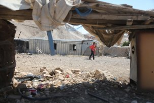 Debris are seen as Palestinians continue to wait in Khan al-Ahmar village after Israeli High Court temporarily suspends demolishing until July 11 in Jerusalem on 6 July, 2018 [Issam Rimawi/Anadolu Agency]