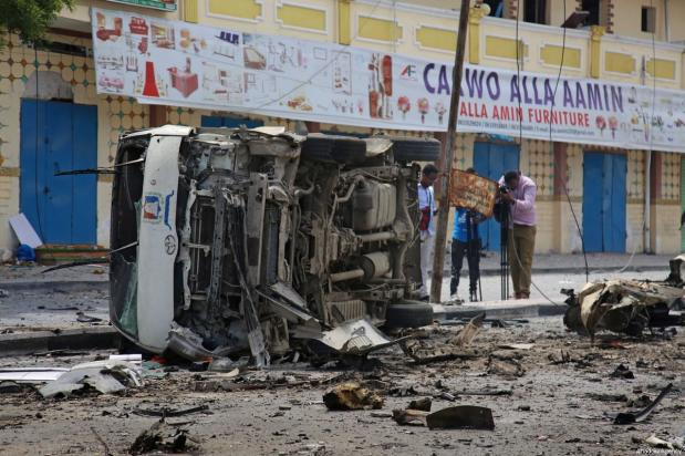 A damaged vehicle is seen after a bomb laden car attack by al-Shabab militants in front of Interior Ministry in Mogadishu, Somalia on July 07, 2018 [Sadak Mohamed / Anadolu Agency]