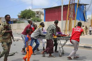 An injured person is being carried to an ambulance with a stretcher after a bomb laden car attack by al-Shabab militants in front of Interior Ministry in Mogadishu, Somalia on July 07, 2018 [Sadak Mohamed / Anadolu Agency]