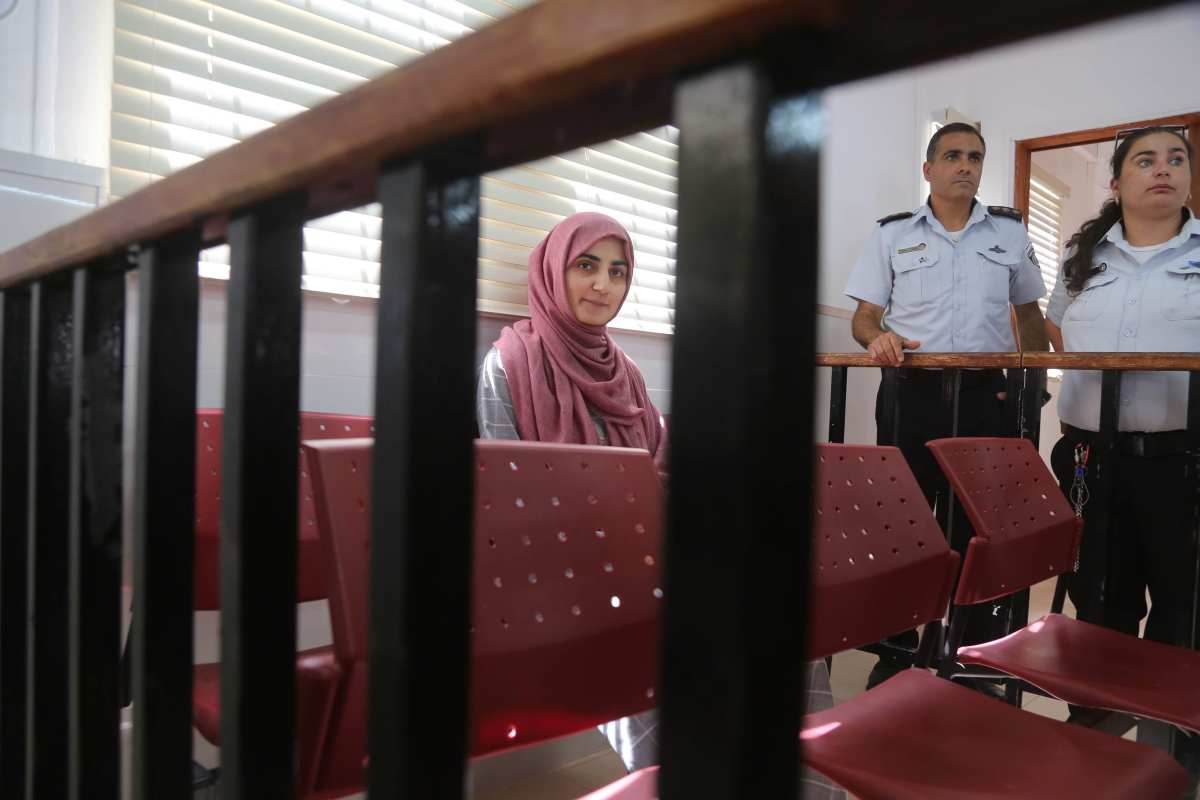 Ebru Ozkan, 27, was arrested by Israeli forces at Ben Gurion Airport on June 11 when she was returning to Turkey for alleged links with terrorist groups, is seen ahead of her trial at Ofer Military Court in Ramallah, West Bank on 11 July, 2018 [Issam Rimawi/Anadolu Agency]