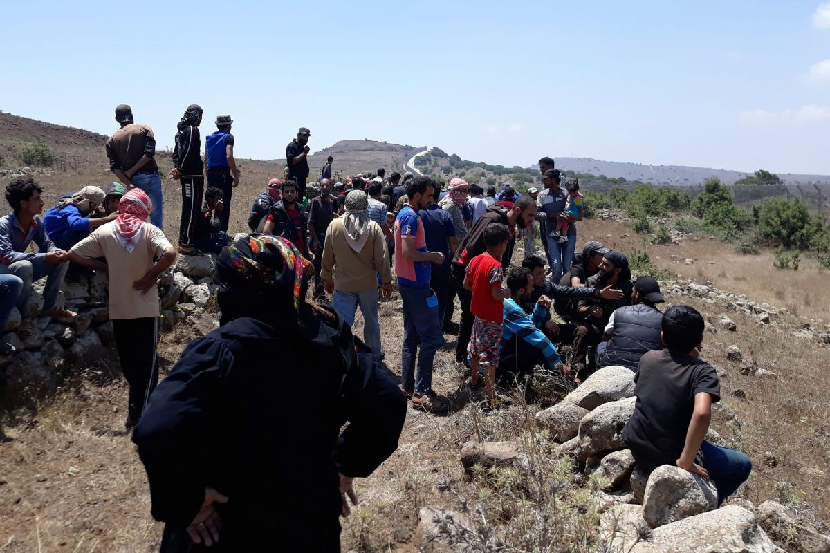 Approximately 200 civil Syrians who fled from the Assad regime's strikes over Daraa and Quneitra districts, are close to occupied Golan Heights near Israeli Border in Daraa, Syria on 17 July, 2018 [Ammar Al Ali/Anadolu Agency]
