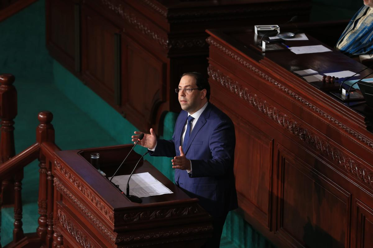 Tunisian Prime Minister Youssef Chahed addresses lawmakers durinh the parliament session on vote of confidence for Hisham al-Furati appointed as Minister of the Interior, in Tunis, Tunisia on 28 July, 2018 [Yassine Gaidi/Anadolu Agency]