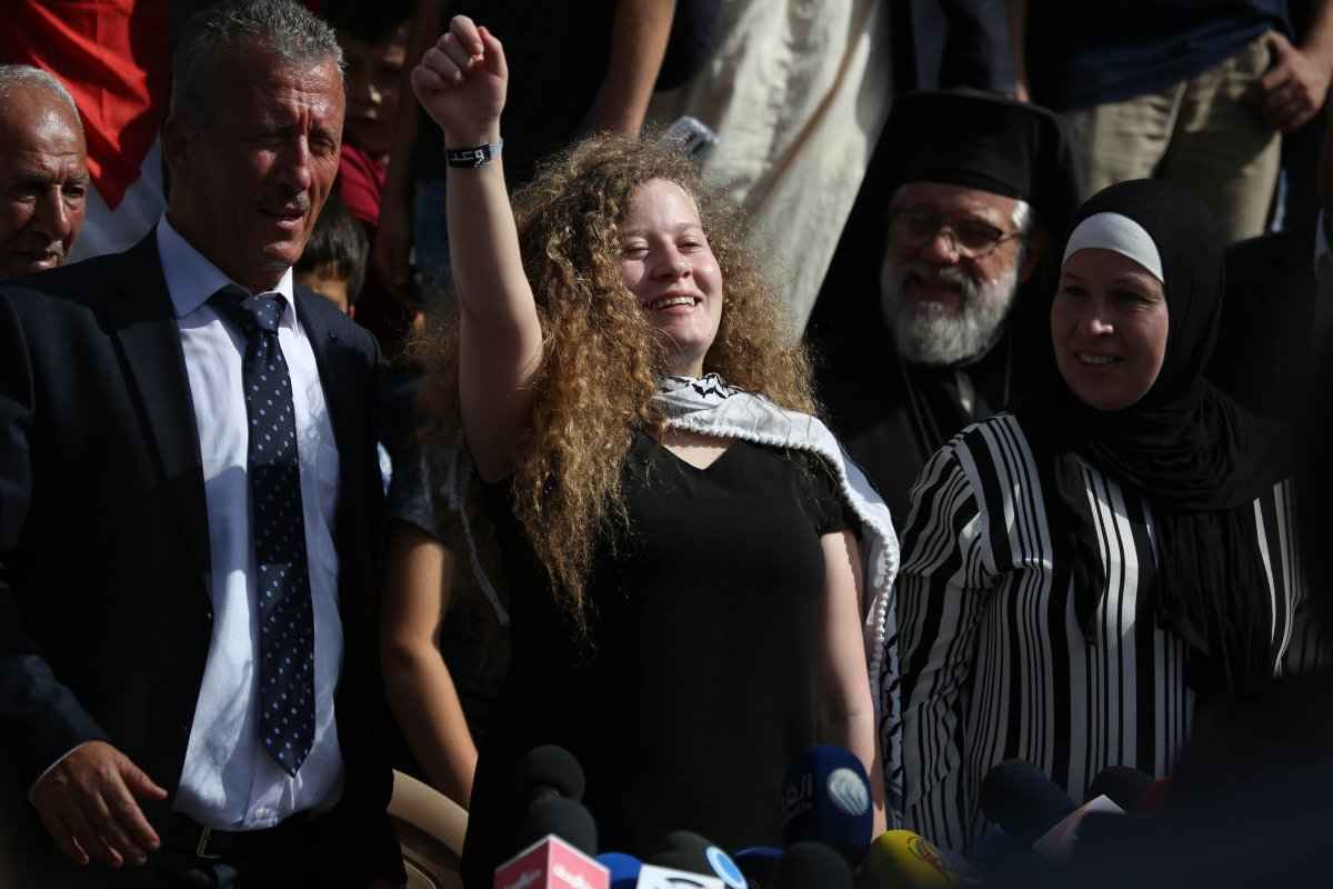 Palestinian teenager Ahed al-Tamimi (C) holds a press conference with her mother Nariman Tamimi (not seen) and her father Basil Tamimi (not seen) in Nabi Salih village of Ramallah, West Bank on 29 July, 2018 [Issam Rimawi/Anadolu Agency]