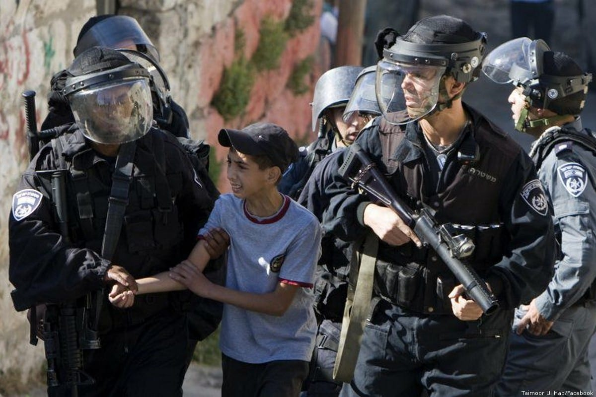 Israeli forces can be seen arresting a Palestinian child [Taimoor Ul Haq/Facebook]