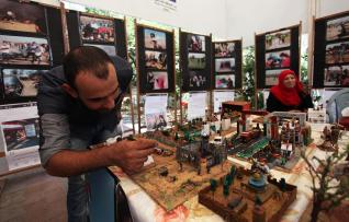 "Palestinians attend an exhibition for the ""Great Return March"", in Gaza City on 24 July, 2018 [Mahmoud Ajour/Apaimges]"